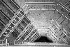 into darkness (Blende1.8) Tags: staircase treppenhaus stairs stairway banister treppengeländer tiefe deep architecture indoor indoors interior mono monochrome monochrom building line lines carstenheyer fuji fujinon fujifilm bw schwarz weiss black white xt1 xf1855mm