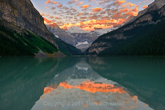 Symmetry (pdxsafariguy) Tags: canada lakelouise alberta nationalpark banff sunrise clouds reflection symmetry mountain glacier lake landscape water forest blue snow turquoise calm mountains trees serene tomschwabel