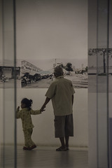 Looking back (Keith Kelly) Tags: asia cambodia granddaughter institutfrancaisducambodge kh kampuchea phnompenh seasia sangkatboengreang southeastasia thefrenchculturalcenterofcambodia aroundtown art capital city gallery grandfather lookingback photography photos remembering