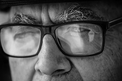 The soul of a priest (Giulio Magnifico) Tags: closeup macro hat friuli blackandwhite vintage thoughts soulful friulano eyes streetphotography detail old personality gaze deepsoul look thought power glasses micro detailing udine ancient italy nikond800enikkor105mmmicrof28afs bw church 105mm priest catholic taglio traditional