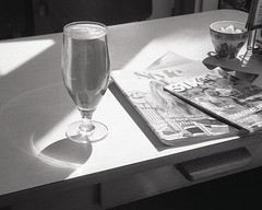 lazy afternoon (OhDark30) Tags: olympus 35rc 35 rc film 35mm monochrome bw blackandwhite bwfp beer magazines cafe formica