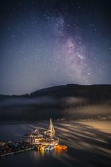 Starry night (kubaszymik) Tags: night long exposure longexposure longexpo stars sky milkyway milky way colors lake nightscape boat water poland rożnów canon 6d 35l