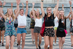 Dancing For Joy (Ron Scubadiver's Wild Life) Tags: girl woman candid street style nikon 24120 lisbon portugal outdoor people group denim shorts romper dancers