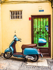 Scootèr. (CWhatPhotos) Tags: cwhatphotos bike two wheels blue yellow window next scooter doorway puerto del la cruz tenerife going holiday holidays photographs photograph pics pictures pic picture image images foto fotos photography artistic that have which with contain olympus esystem four thirds digital camera lens 43 mft micro
