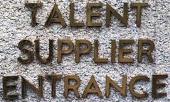 talent supplier entrance (n.a.) Tags: nl amsterdam holland netherlands brass sign pebbledash wall dam