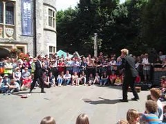Streetcomedy (catrionatv) Tags: winchester hatfair square museum trees crowd audience act hilarious juggling streetcomedy video