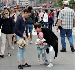 Baby in the center (bokage) Tags: sweden stockholm bokage street woman baby