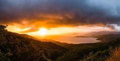 Corsican sundown03 (Steppenwolf33) Tags: steppenwolf33 sundown rain clouds sky twilight mountain sea landscape