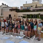 The Honors group who traveled to Greece pose together on the roof of the Athens Centre.