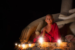 A boy in buddhism set fire with candle in bagan (anekphoto) Tags: myanmar monk budha mandalay bagan temple old burma buddha yangon mini traditional culture small asia religion buddhism child statue meditation travel vintage landscape people architecture asian thailand cambodia laos candle light dark night tourism ancient boy ethnicity praying shrine pagoda yang gon yanggon chiangmai chiangrai sit young kid baby wat