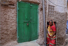 doors, jodhpur (nevil zaveri (thank you for 15 million+ views)) Tags: zaveri india jodhpur woman women door rajasthan photography photographer images photos blog stockimages photograph photographs nevil nevilzaveri stock photo old architecture exterior people