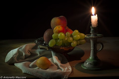 inverno in estate (winter in summer) (anto maccioni) Tags: beautifulexpression low light caravaggio still life ombre summer fruit candle example excellent winner flickr nikonflickaward wow flickrfriday wowl2