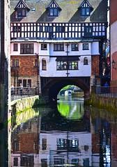 Glory Days (Nanny Bean) Tags: reflection distortion gloryhole lincoln tudorbuildings bridge