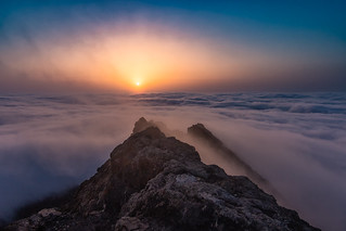 Sunset over  sea of clouds.