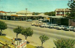 Palm Beach shops on the corner of Fifth Ave and the old Gold Coast Highway - 1960s (Aussie~mobs) Tags: fifthavenue palmbeach goldcoast shops stores palmbeachhotel vintage queensland australia cars 1960s automobiles