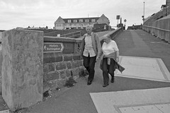 Historic Rottingdean (G Reeves) Tags: nikon nikond300 garyreeves seafront beach sea waves water rottingdean eastsussex brighton blackwhite bw monochrome people couple old sign