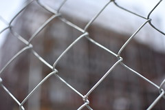Under Construction/Focus (thatSandygirl) Tags: chain link fence construction building outdoor architecture squares lines
