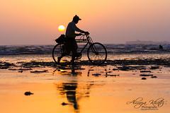 The day has to be end (Aliraza Khatri) Tags: karachi sindh pakistan sunset life cyclying bike fishermen daily dailylife beach silhouette ocean arabiansea aliraza khatri alirazakhatri yehhaikarachi karachiscapes seaviewkahani travel peopleandlife