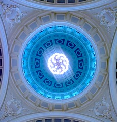 looking up into the blue vault (citizensunshine) Tags: northernireland ireland belfast cityhall townhall blue chandelier hanging dome circle spiral moulding molding