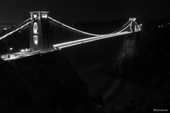 Into The Abyss (HiJinKs Media...) Tags: bridge clifton bristol night city lights longexposure suspensionbridge citylife high heights illuminated citylights historic architecture monument views nikon d90 river avon gorge trees roads path brunel design late alone biancoenero blancoynegro blackandwhite blackwhite bw mono monochrome gap shadows silhouette shadow bricks building cold isambard kingdom