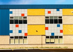 Colourful School (Karen_Chappell) Tags: school building torbay newfoundland nfld canada atlanticcanada avalonpeninsula architecture geometry geometric colourful multicoloured colours colour color window windows rectangle square blue yellow red grey brick