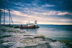 Light house (Maria Eklind) Tags: ven nature water sweden outdoor clouds moln ocean kyrkbacken lighthouse fyr island sky boat himmel landskrona marina båt skånelän sverige se