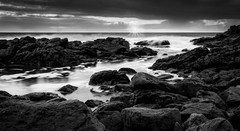 The Setting Sun (*ScottyO*) Tags: fleurieu sa southaustralia carrickalinga australia beach sea ocean shore coast coastal dusk evening sunset landscape seascape panorama blackandwhite bw monochrome moody nature outdoor sky clouds water rocks rocky winter sun sunburst sunbeam