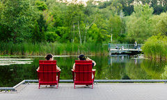 Relaxing in Muskoka Chairs (dtstuff9) Tags: toronto ontario canada evergreen brickworks muskoka adirondack chair pond green red
