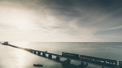 RAIL - 13253 (Vinith GR) Tags: sonya6000 sony sonyalpha apsc sony1018mm landscape rail nature cinematic sunset rameshwaram tamilnadu rameswaram dhanushkodi pamban pambanbridge clouds darkclouds dusk sea bridge seascape boat