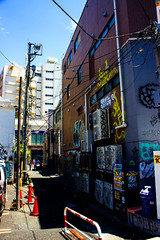 Away from the tourists ツーリストがない (Shutter Chimp: Im back!) Tags: 渋谷 日本 ビル 道路 東京 渋谷区 japan shibuya building tokyo road street photography グラフィティ graffiti power line path blue sky back backstreet sign people 人 人々 ghetto