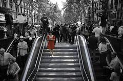 """Aïllada dins la multitud"" / ""Isolated in the crowd"" (nuriapase) Tags: barcelona santjordi blancinegre monocrome blackandwhite red rojo vermell colour larambla woman dona mujer people streetphoto street cutout selectivecolour"