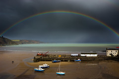 Technicoloured Tenby (snowyturner) Tags: rainbow showers weather harbour boats light rain beach sea coast