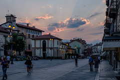 a proposito di luce (Clay Bass) Tags: 35mm saluzzo clouds evening fuji lights natural night people rays street xt1