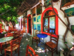 a nice place to drink some coffee (try...error) Tags: red greece crete kreta sun holidays beer urban
