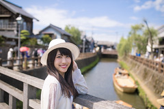 Young woman standing on old wooden bridge in Sawara old Japanese town (Apricot Cafe) Tags: img39421 2024years asia asianandindianethnicities japan japaneseethnicity japaneseculture katoricity sawarakatori sigma35mmf14dghsmart beautifulwoman blackhair boat bridge buildingexterior candid carefree charming cheerful chibaprefecture colorimage cultures day enjoyment happiness horizontal leaning lifestyles longhair lookingatcamera oneperson onlyjapanese onlywomen onlyyoungwomen onoriverchibaprefecture outdoors people photography railing river smiling standing strawhat sustainablelifestyle toothysmile tourism tourist traveldestinations waistup women youngadult
