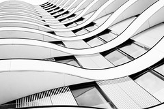 Stark Living (Sean Batten) Tags: london england unitedkingdom gb nikon df 35mm blackandwhite bw city urban building apartment flats housing lines curves riverwalk vauxhall geometry geometric