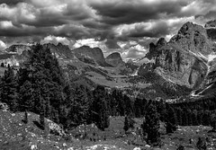Dolomite Scenery (bjorbrei) Tags: mountains valley trees forest pines sky clouds sella selva wolkenstein valgardena gröden gherdëina dolomites dolomiten dolomiti tyrol tirol tirolo italy italia