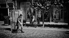 The Silent Contact (Alfred Grupstra) Tags: blackandwhite people urbanscene street outdoors men city citylife cultures editorial old sidewalk bicycle travel architecture oldfashioned town walking roller contact streetphotography