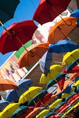 Colourful Umbrella Installation - Kingston - London (Lauren Taliana) Tags: sky green streetart street parasols parasol elements umbrella umbrellas bright colourful colour orange blue red yellow installation modern kingston flickr ornament ornamental london
