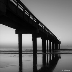 Sunrise at St. Augustine Pier (bill.lepere) Tags: blepere stjohnscounty florida pier staugustine blackandwhite perspective squareformat sunrise ocean lowtide canon60d beach staugustinebeach earlymorning bluehour
