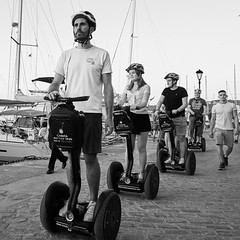 The Segway Tour (rasmusthepood) Tags: summer greece chania segway tourist harbour harbor monochrome blackandwhite street