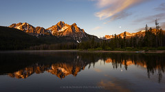 Sawtooth Wilderness (Bob Bowman Photography) Tags: moonset sunrise mountains morning light trees lake reflection idaho stanley wilderness forest alpine landscape water sky moon