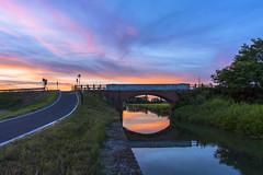Ponte Cascina dell'acqua (William Tagliaferri) Tags: naviglio bereguardo besate cascina dellacqua ponte sunset pink orange water reflection dusk tramonto acqua riflesso conca riviera sky clouds nuvole blu