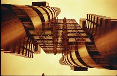 Double helix. (von8itchfisk) Tags: redscale red lloyds building architecture lomography film f2400 flipped double exposure vonbitchfisk london olympus om10