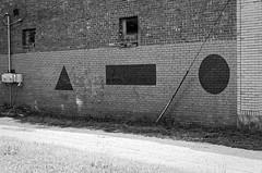 symbols of unknown origin (fallsroad) Tags: urban tulsaoklahoma city bw blackandwhite wall brick signs symbols shapes