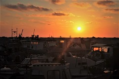 Getting Red (Photogioco) Tags: sunsets mare mediterraneo mediterraneansea fishingport red oldcity orange sea beautiful boats lifestyle lights