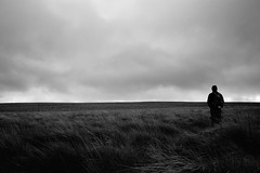 Lonely Hiker (graemes83) Tags: pentax dailyin selfie self portrait person figure black white monochrome hills cloud rain bleak dark