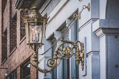 ornate charleston gaslamp (laughlinc) Tags: gold nikon7200 architecture charleston nikon ornate gaslamp 105mm28 marketpavilionhotel