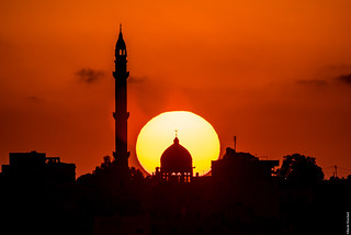 Sun Behind Mosque Moon