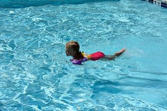 Swimming along in her Floaties (Jellybeens Photography) Tags: swimming pool community apartment complex floaties blonde hair little girl swim summertime leisure activity blue water awesome open lovely amazing